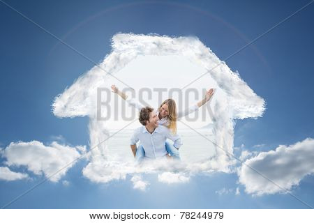 Man piggybacking woman at beach against cloudy sky with sunshine