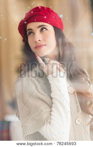 Portrait of a brunette in day dreaming against snow falling