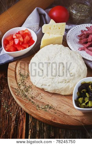 Dough And Ingredients For Pizza
