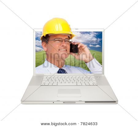 Laptop And Man With Hard Hat On Cell Phone