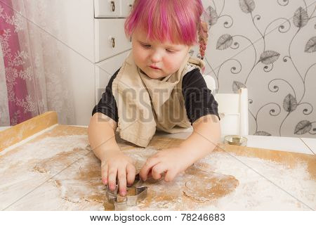 Girl baking Christmas cookies