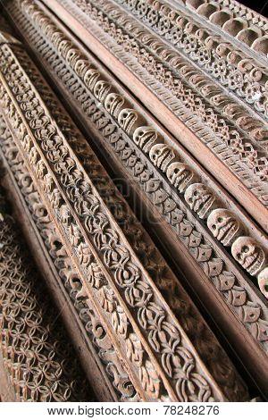 KATHMANDU, NEPAL - APRIL 2014 : Details of wooden entrance carved in skulls and other patterns at Hanuman Dhoka, Old Royal Palace in Kathmandu, Nepal on 12 April 2014.