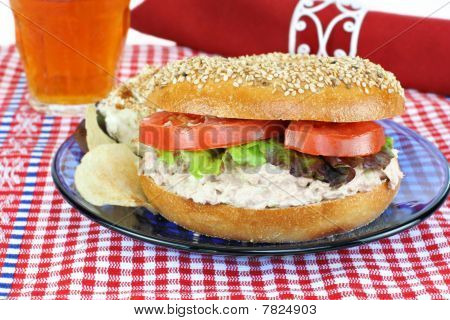Tuna Salad Sandwich On A Sesame Bagel.