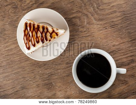 Piece Of Chocolate Cake On A Plate And Black Coffee