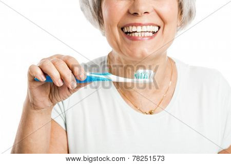 Portrait of a happy old woman brushing her teeth