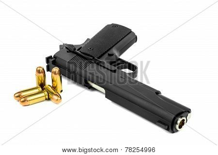 pistol and bullet isolated on white