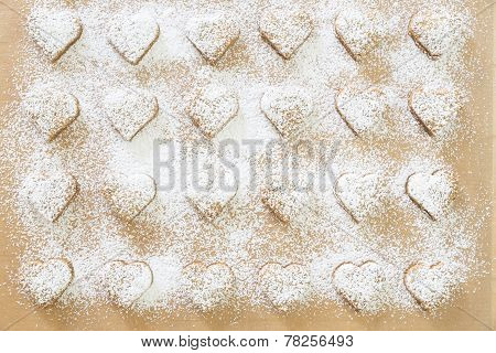 Heart-shaped Christmas cookies with powder sugar icing