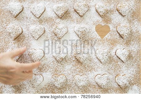 Heart-shaped Christmas cookies, hand stealing one