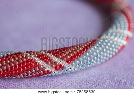 Necklace Fragment From Small Beads On A Textile Background