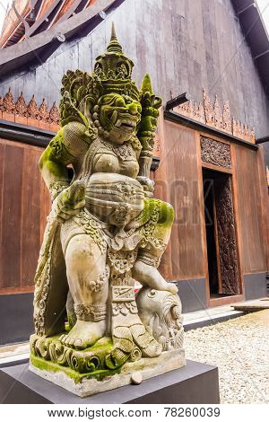 Guardian statue in Baan Dam Temple, Thailand