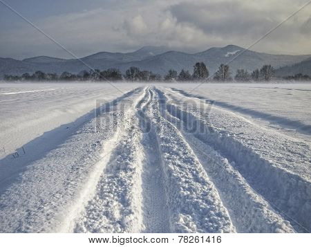 Snowy Road Through Snowy Fields