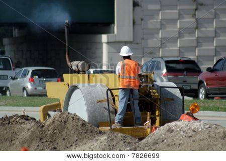 Worker Operating a Compactor (2)