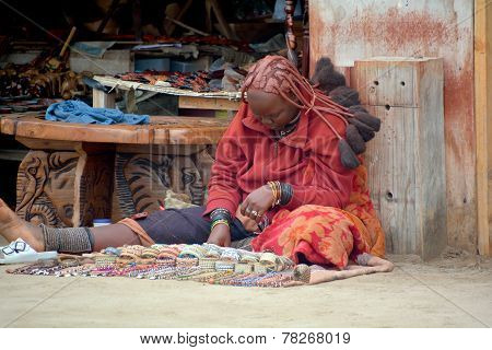 woman from Himba tribe sale souvenirs