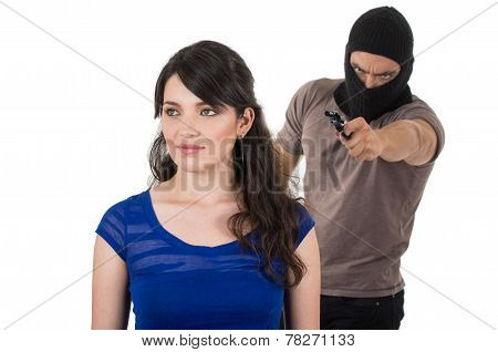 male thief with gun ready to rob young girl