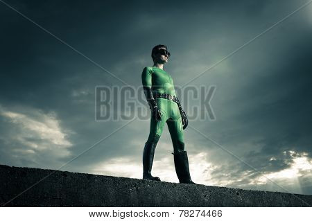 Superhero Standing On A Concrete Wall