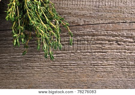 Thyme On A Wooden Board