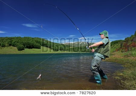 A fisherman fishing on a Mavrovo lake
