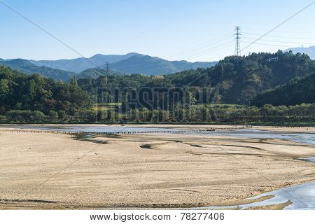 Yeongju, Korea - October 15, 2014:  People On A Single Lane Bridge In Museom Village