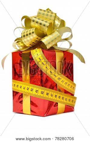 Red gift and measure tape
