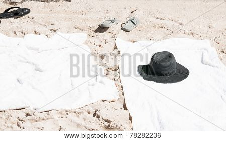 Beach towels and black hat.