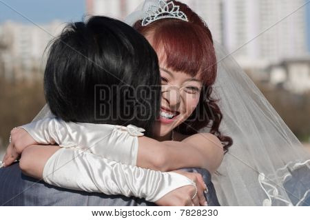 Smiling Happy Bride Embracing Groom