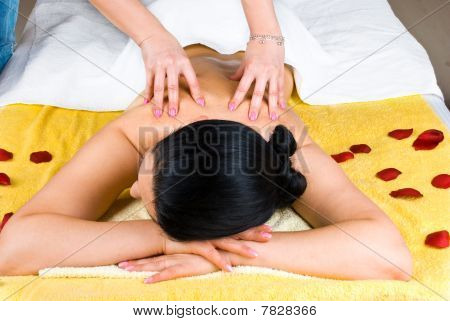 Woman Back Massaging With Oil At Spa