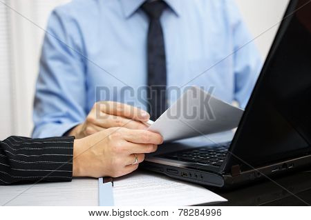 Consultant And Client Are Working With Documents And Laptop On Office Desk