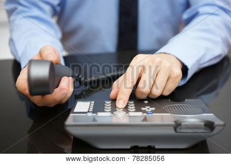 Businessman Is Dialing On Telephone Keypad