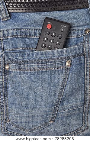 Black remote control placed in jeans pocket