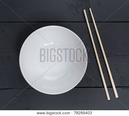 Bowl With Chopsticks On A Black Wooden Bird's Eye View