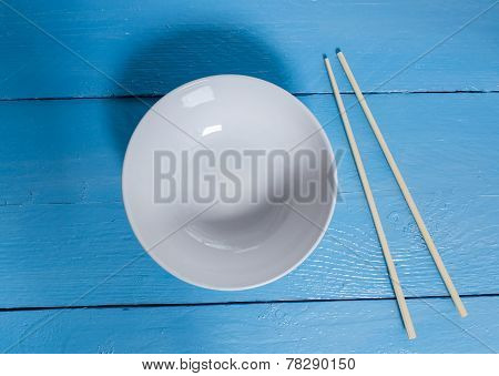 Bowl With Chopsticks On A Blue Wooden Bird's Eye View