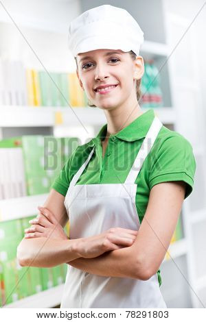 Smiling Supermarket Worker Amrs Crossed