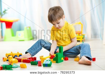 kid boy playing with block toys at home