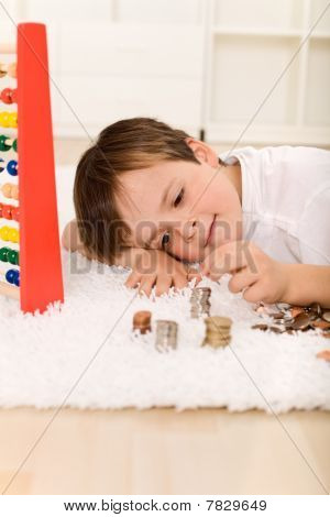 Little Boy Counting His Money