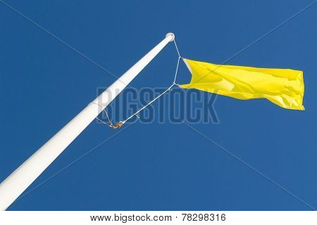 Yellow Flag And Blue Sky