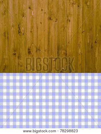 Wooden background with purple tablecloth