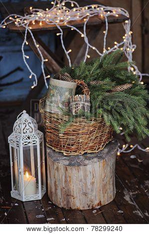 Christmas lights, lantern and basket of fir branches