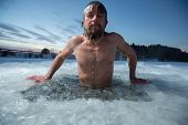 pic of bathing  - Young man bathing in the ice hole - JPG