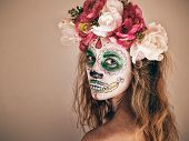 stock photo of scary  - Portrait of woman with wreath and scary halloween makeup - JPG