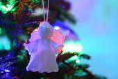 stock photo of christmas angel  - Knitted Christmas angel on Christmas tree - JPG