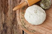 pic of food preparation tools equipment  - cooked dough for pizza and spices on an old wooden table - JPG