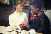 foto of mans-best-friend  - Laughing friends talk and drink coffee in cafe good friend enjoying coffee in beautiful place cold winter days in beautiful coffee shop friends at breakfast having coffee and enjoying themselves - JPG