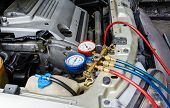 picture of liquids  - filling liquid of air conditioning for car