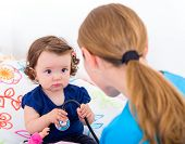 image of scared baby  - Adorable baby look scared at the doctor - JPG