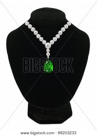 Diamond And Emerald Necklace On Black Mannequin Isolated On White