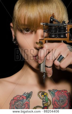 Tattooed Beautiful Woman With Tattoo Machine