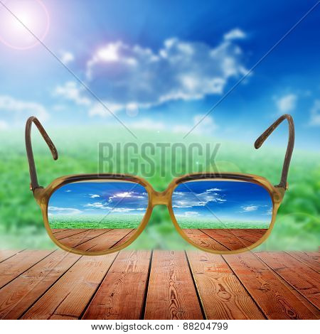 Vegetables fields and blue sky with eye glasses