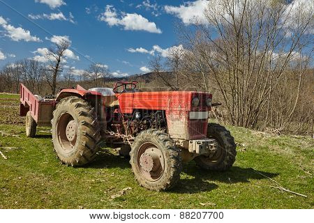 Dirty Tractor On A Field