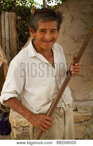 Close up portrait of local man from the small town Sacachun in Snta Elena province, Ecuador