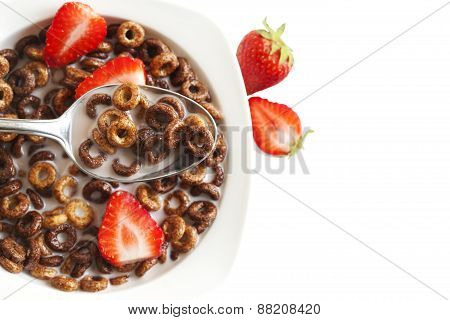 Chocolate Cereals And Strawberries For Breakfast Closeup.